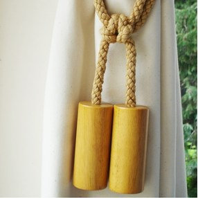 wooden cylinder curtain tieback in wax with cotton embrace