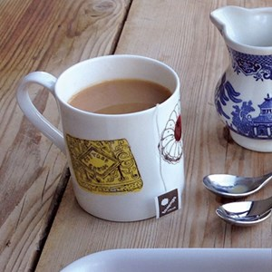 family favourites china mug with a selection of nice, bonbon, tunocks, wafer, digestive biscuits