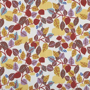 autumn coloured leaves are printed on golden orchard oil cloth by Victoria Mollgard