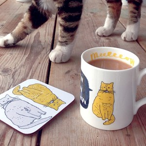 meow china mug by charlotte farmer with oscar the cat standing in background