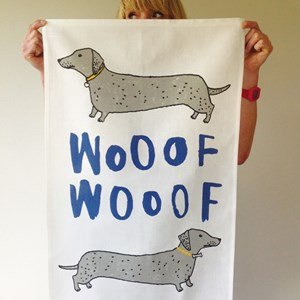 wooof kitchen tea towel of dachshund or sausage-dogs by illustrator charlotte farmer