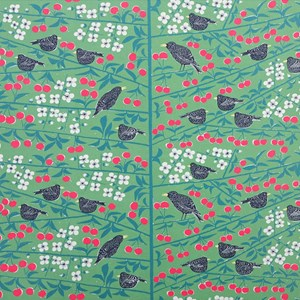 green cherry orchard cotton fabric print of blackbirds eating cherries in a tree