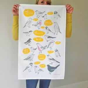 tweet kitchen tea towel with garden birds tweeting, yellow & black print on cotton/linen