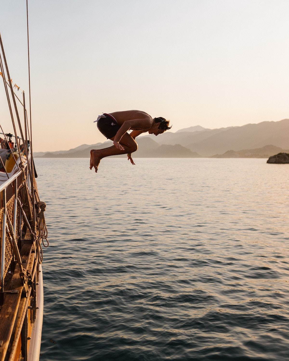 Young man jumping into the sea during the Blue Cruise in Turkey