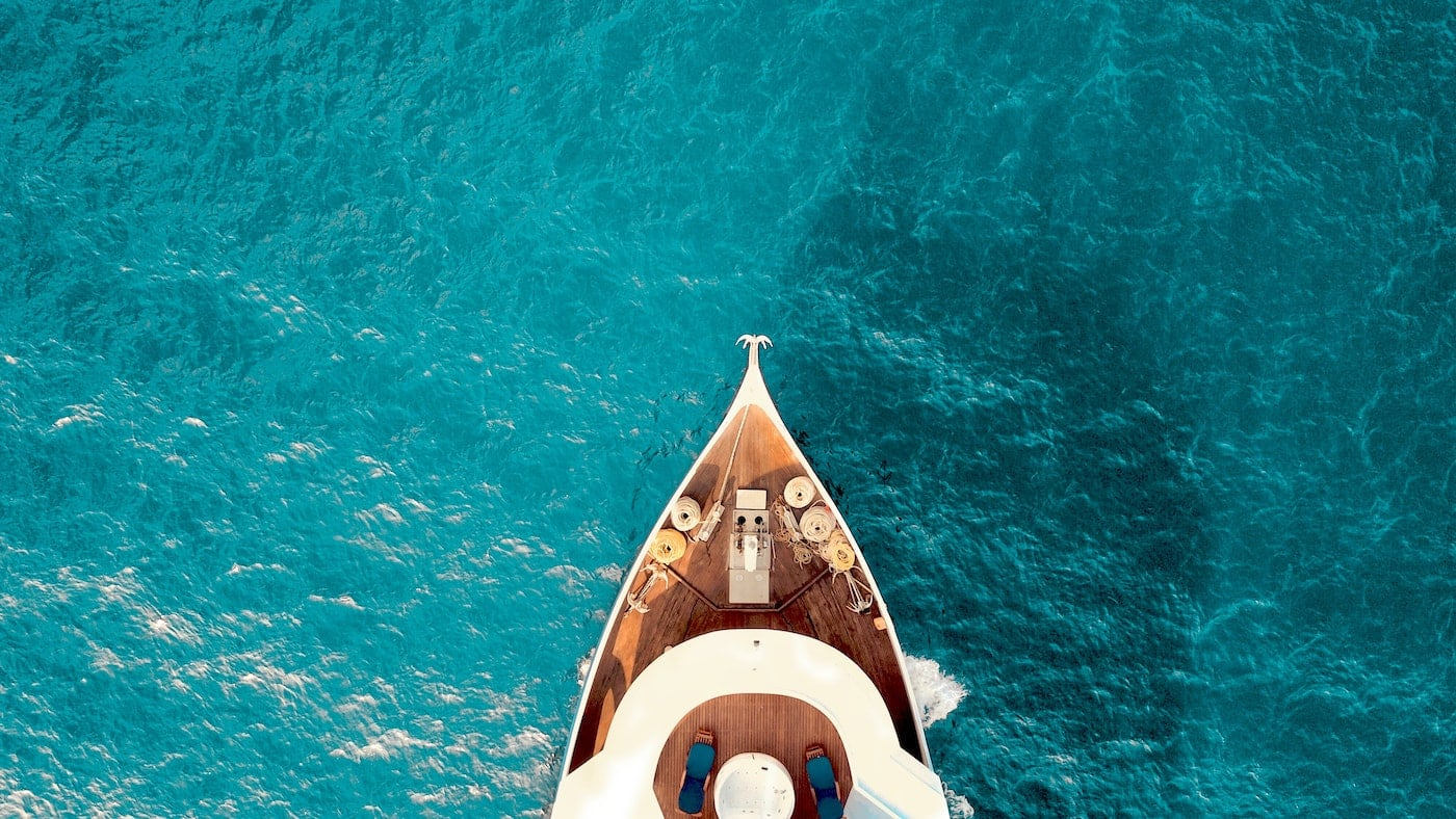 Aerial view of luxury ship in Cyclades islands.