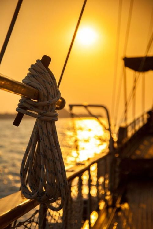 Sailing in Croatia at sunset on a sailboat in the Kornati Islands.
