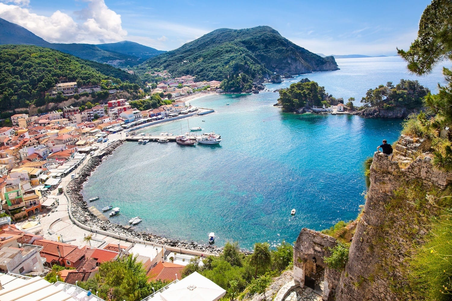 Man enjoying the views of Parga bay, Greece