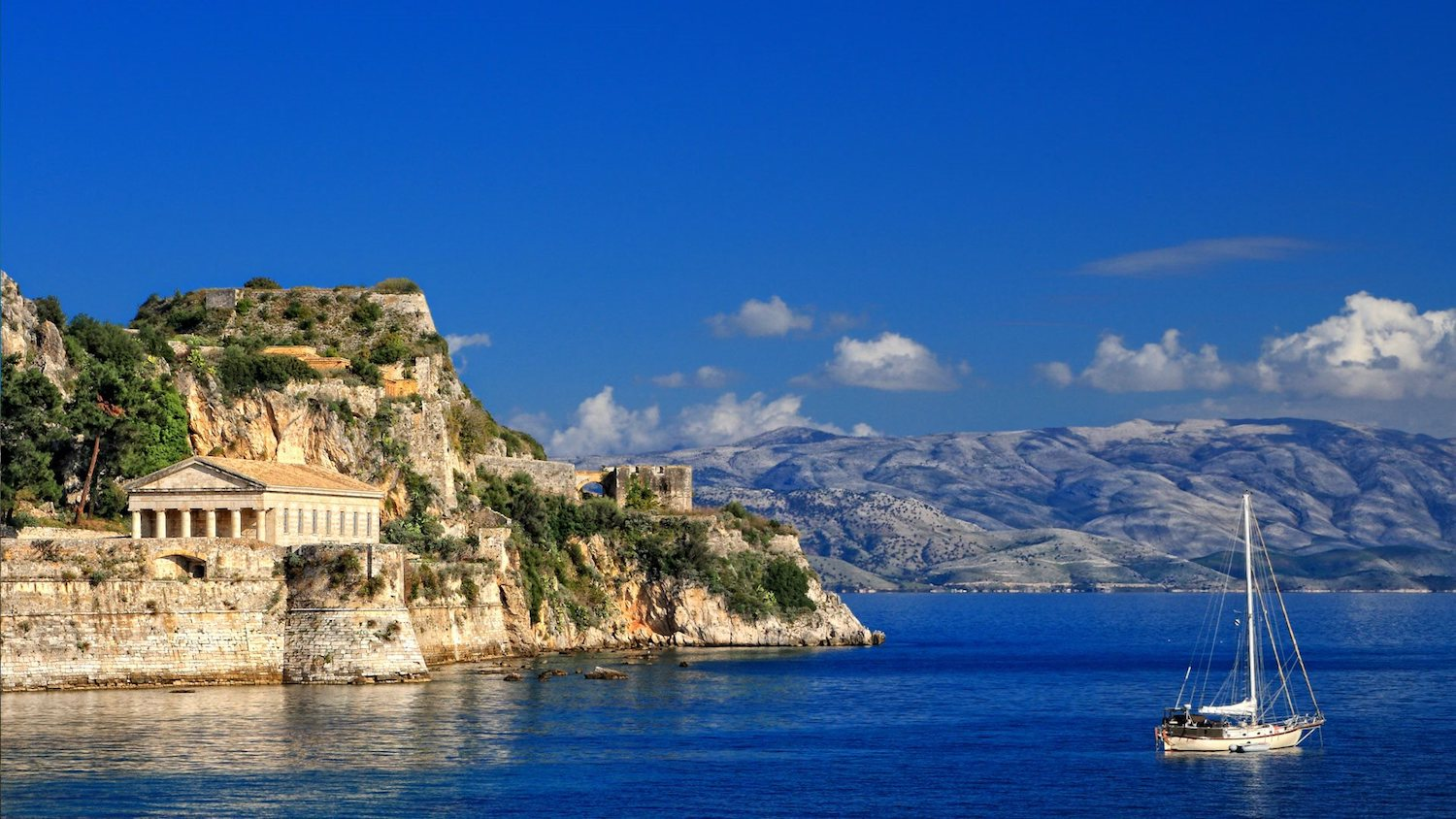 Yacht charter sailing in the blue waters of Corfu