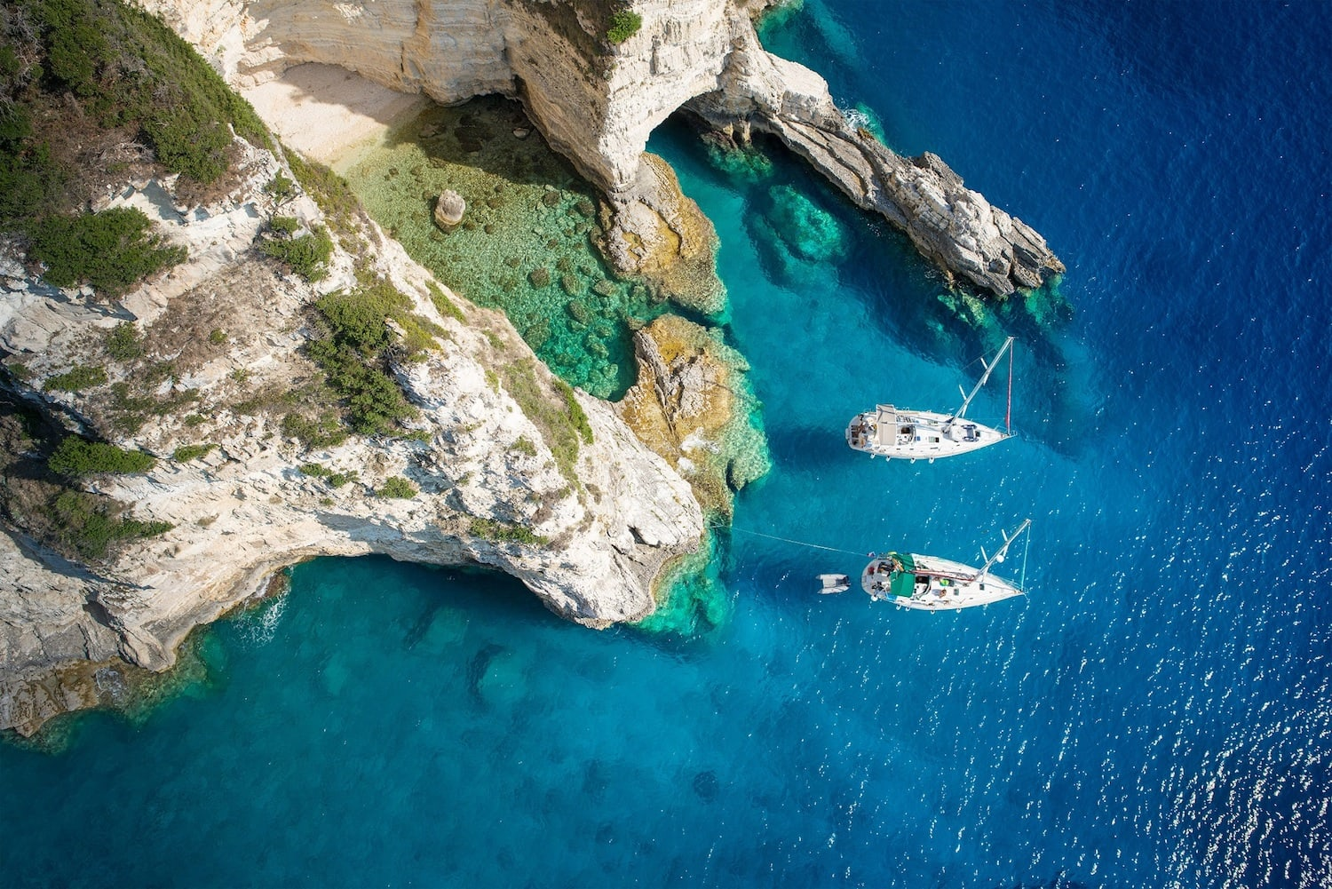 Yachts enjoying a secret cove in Paxos