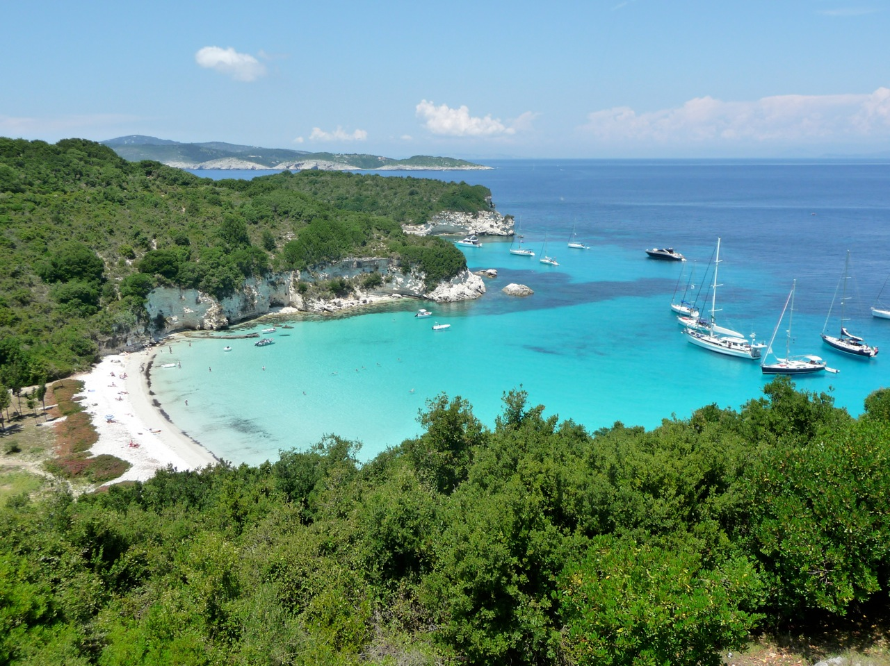 Hired boats anchored in Voutoumi beach in the North Ionian Islands
