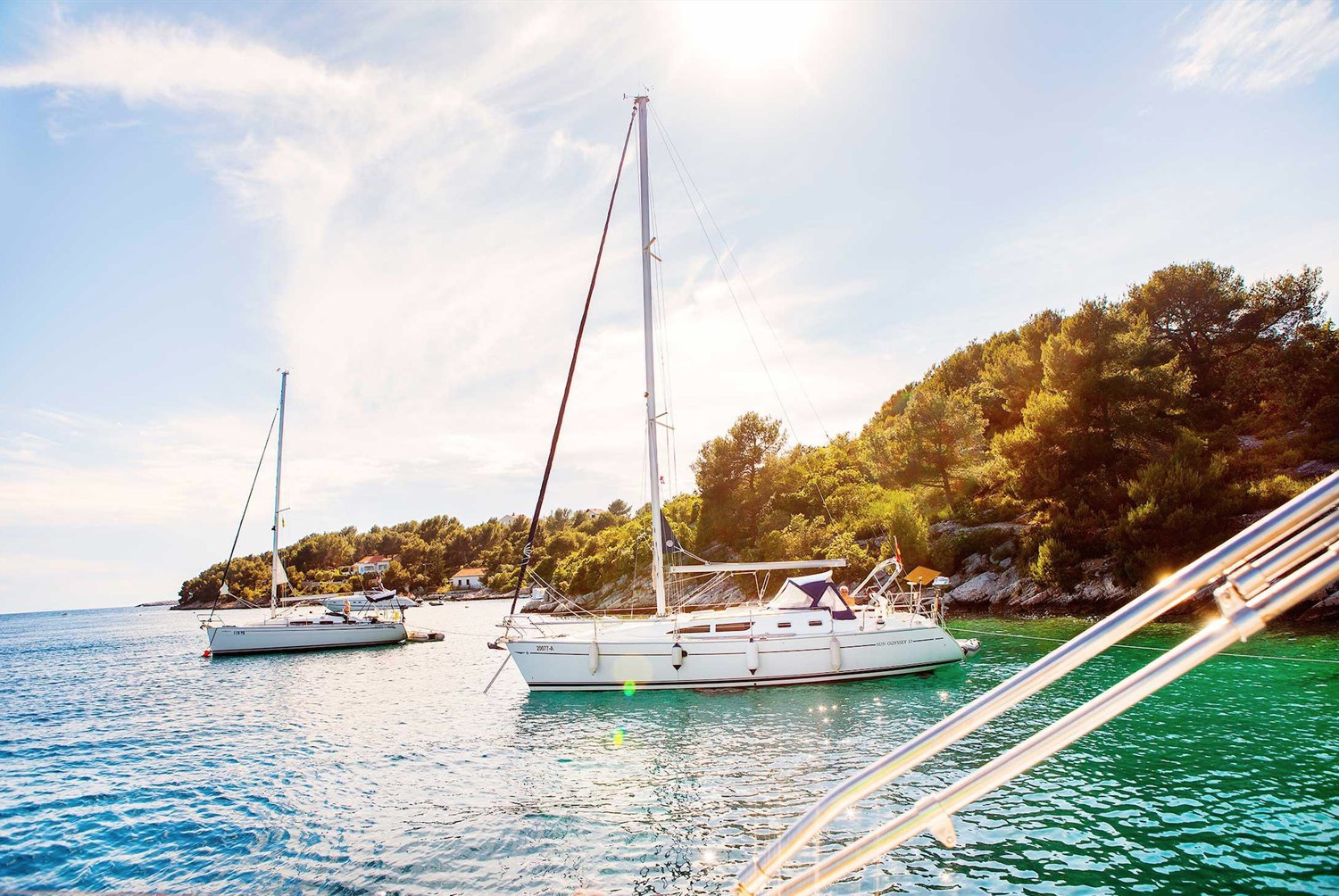 Sailboats and motor yacht anchored in a paradise cove in Croatia