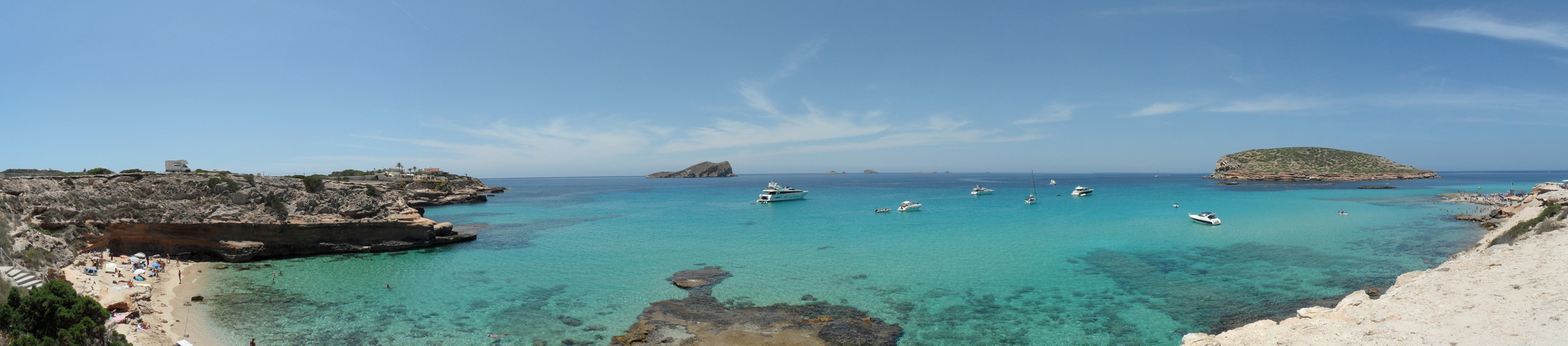 Yachts, sailboats and motorboats anchored in Cala Conta (Ibiza).