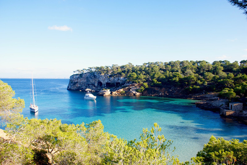 Yachts for charter in the turquoise waters of cove Portals Vells (Majorca).