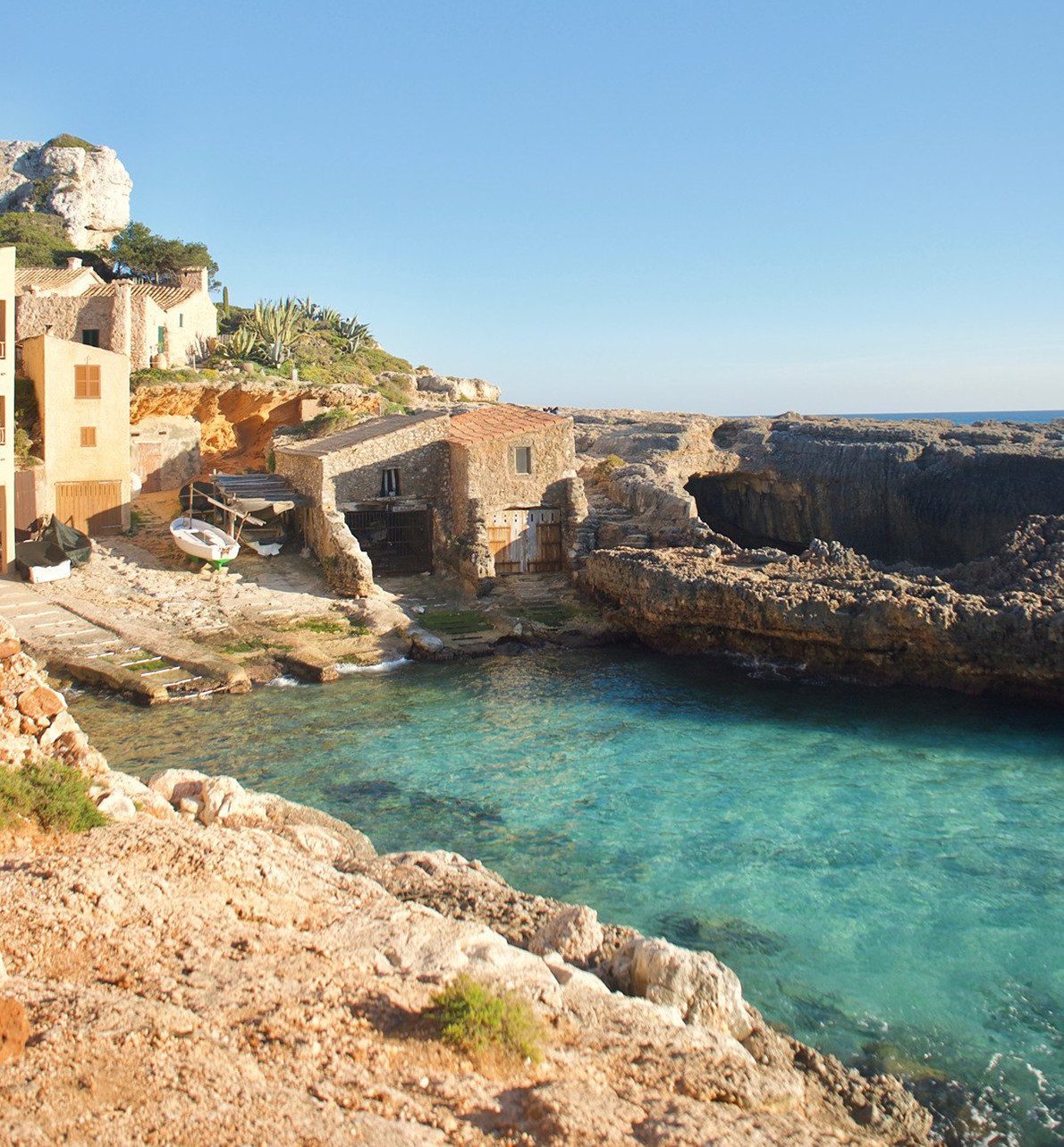 Picturesque fishermen's huts in cala S´Almunia (Mallorca)
