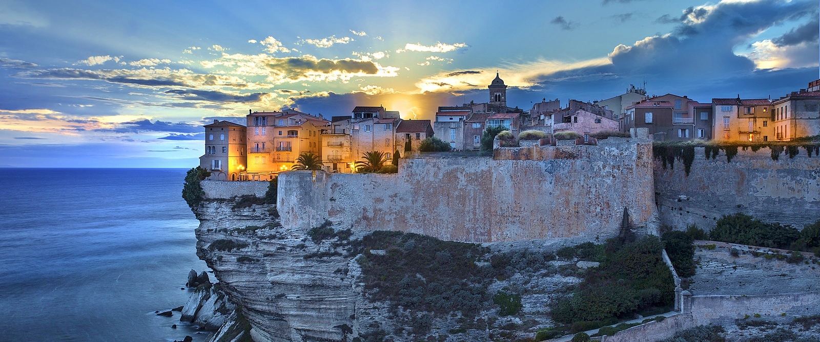 Sunset at the old town of Bonifacio over the cliff (Corsica)