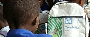 boy with schoolbag made of recycled plastic bags