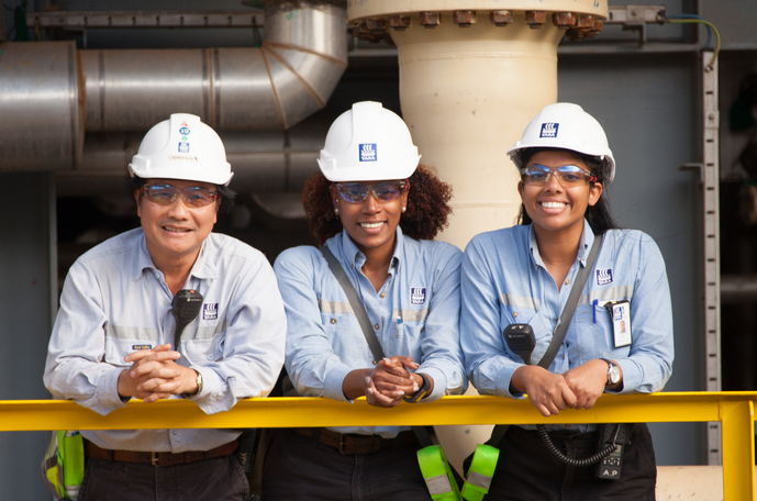 Three female workers in production plant