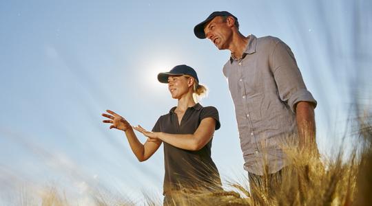 Two farmers on a wheat field
