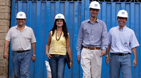 two men and a woman in hard hats walking