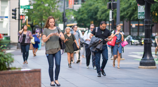Young woman using her phone in the city