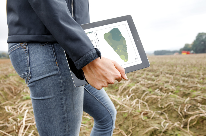 Digital farmer in a field with iPad