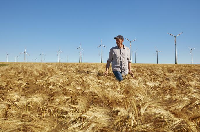 Farmer in barley field, Germany