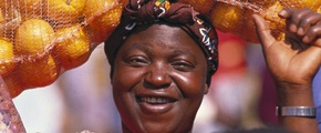 African woman, carrying oranges on here head