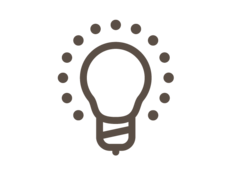Lightbulb with halo of dots icon