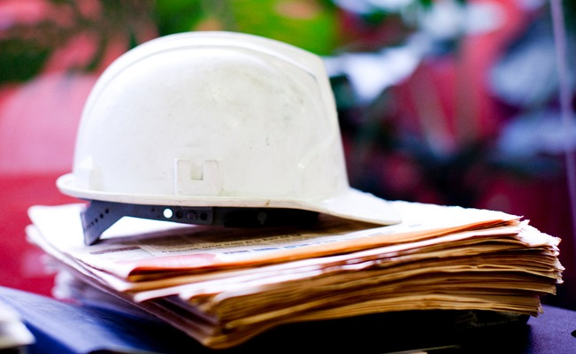 Hard hat and documents