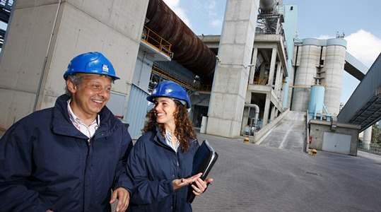 2 people at cement plant walking