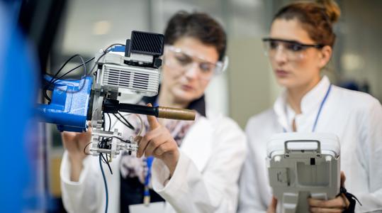 Two engineers working on robotics