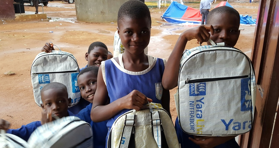 Children with school bags made of recycled fertilizer bags