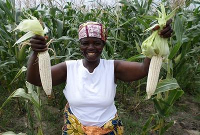Smiling woman corn farmer, Africa