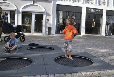 children playing in a city street