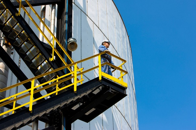Man on silo steps