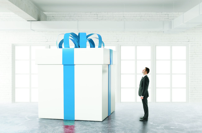 Man looking at enormous gift
