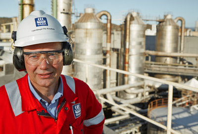 A man in front of nitric acid plant