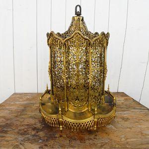 Restauration d'une lanterne en bronze doré Alice