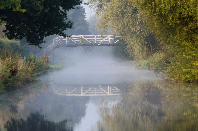 Canal bridge in the mist