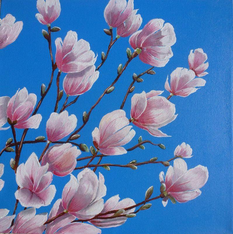 Magnolia blossom on blue